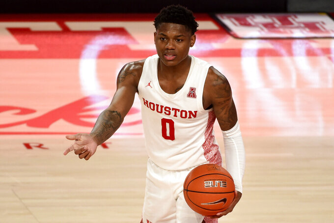 Houston guard Marcus Sasser directs teammates during the second half of an NCAA college basketball game against Lamar, Wednesday, Nov. 25, 2020, in Houston. (AP Photo/Eric Christian Smith)