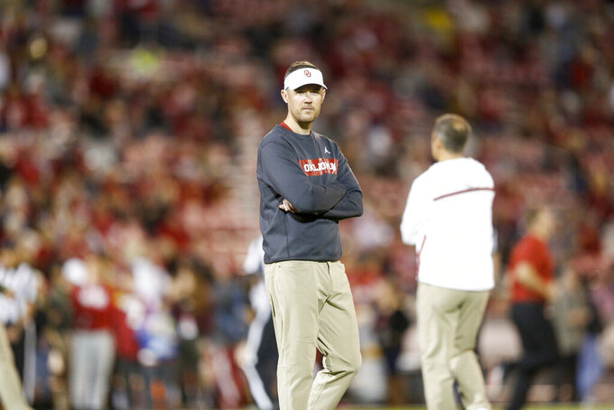 Oklahoma coach Lincoln Riley looks at his team during warmups for the team's NCAA college football game against Iowa State on Saturday, Nov. 9, 2019, in Norman, Oka. (Ian Maule/Tulsa World via AP)