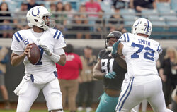 Indianapolis Colts quarterback Jacoby Brissett, left, looks for a receiver as guard Braden Smith (72) blocks Jacksonville Jaguars defensive end Yannick Ngakoue (91) during the first half of an NFL football game, Sunday, Dec. 29, 2019, in Jacksonville, Fla. (AP Photo/John Raoux)