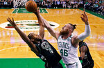 Boston Celtics center Aron Baynes (46) battles for a rebound against Milwaukee Bucks forward Khris Middleton, left, during the first quarter of Game 2 of an NBA basketball first-round playoff series in Boston, Tuesday, April 17, 2018. (AP Photo/Charles Krupa)