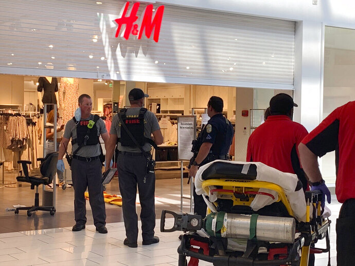 Authorities continue their investigation of a shooting at Riverchase Galleria shopping mall, Friday, July 3, 2020, in Hoover, Ala., that left an 8-year-old boy dead and three other people hospitalized. (Carol Robinson/The Birmingham News via AP)