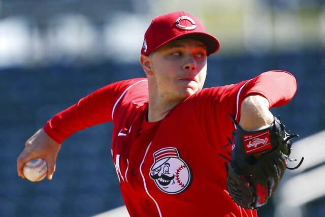 Cincinnati Reds starting pitcher Sonny Gray throws against the Seattle Mariners during the first inning of a spring training baseball game Wednesday, Feb. 26, 2020, in Goodyear, Ariz. (AP Photo/Ross D. Franklin)