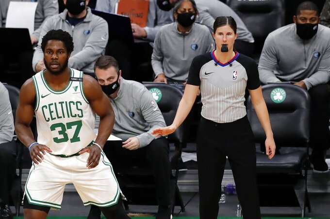 Referee Natalie Sago officiates behind Boston Celtics' Semi Ojeleye (37) during the first half of an NBA basketball game against the Memphis Grizzlies, Wednesday, Dec. 30, 2020, in Boston. (AP Photo/Michael Dwyer)