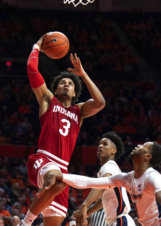 Indiana forward Justin Smith (3) shoots against Illinois guard Alan Griffin (0) and guard Trent Frazier (1) during the second half of an NCAA college basketball game in Champaign, Ill., Thursday, March 7, 2019. (AP Photo/Stephen Haas)