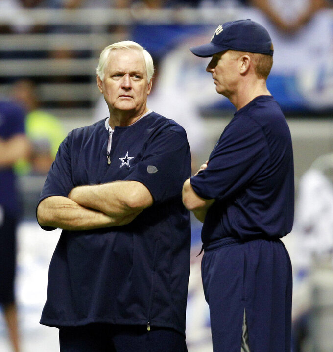"FILE - In this Aug. 2, 2010, file photo, then-Dallas Cowboys head coach Wade Phillips, left, and then-offensive coordinator Jason Garrett chat during the team's NFL football training camp, in San Antonio. Phillips,  the 71-year-old Los Angeles defensive coordinator who was fired as Dallas' head coach in 2010 and replaced by his assistant, Jason Garrett, calls this weekend's divisional playoff showdown "" a revenge game for me."" (AP Photo/Eric Gay, File)"