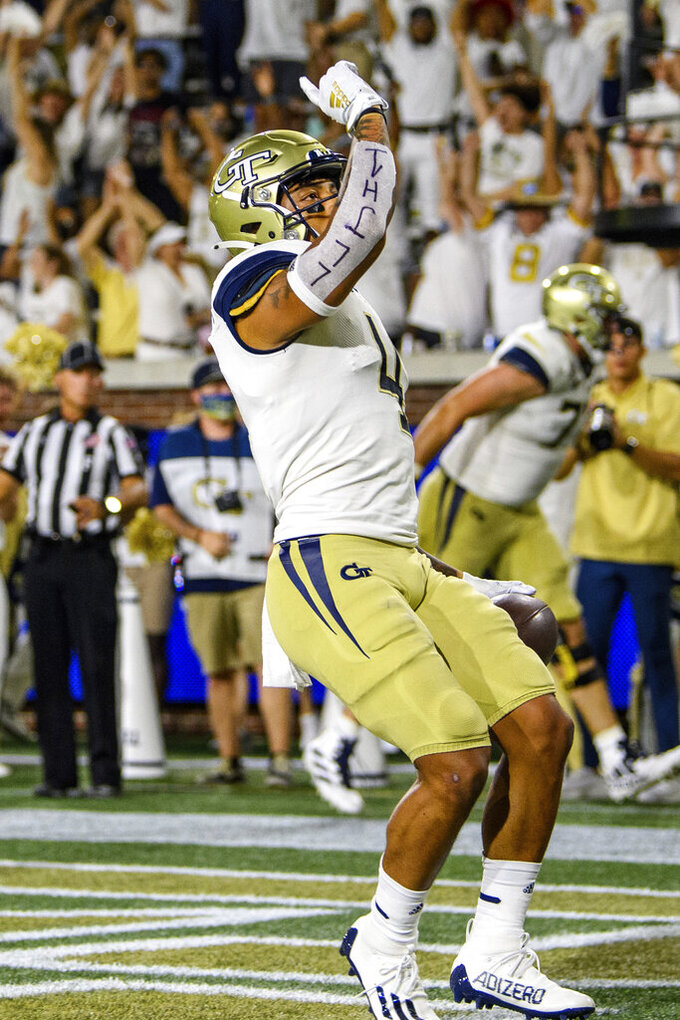 Georgia Tech running back Dontae Smith scores a touchdown during the second half of the team's NCAA college football game against Northern Illinois on Saturday, Sept. 4, 2021, in Atlanta. (AP Photo/Danny Karnik)