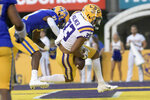 LSU wide receiver Trey Palmer (33) scores a touchdown against McNeese State defensive back Andre Sam (21) during the first half of an NCAA college football game in Baton Rouge, La., Saturday, Sept. 11, 2021. (AP Photo/Matthew Hinton)