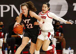 Virginia Tech's Cayla King (22) drives by North Carolina State's Raina Perez (2) during the first half of an NCAA college basketball game, Sunday, Jan. 24, 2021 in Raleigh, N.C. (Ethan Hyman/The News & Observer via AP)