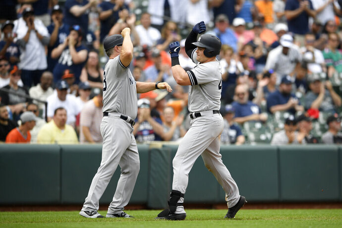 New York Yankees' Luke Voit, right, celebrates his home run with third base coach Phil Nevin (88) during the eighth inning of a baseball game against the Baltimore Orioles, Thursday, May 23, 2019, in Baltimore. The Yankees won 6-5. (AP Photo/Nick Wass)