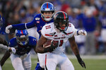 Texas Tech tight end Donta Thompson (11) gets away from Kansas linebacker Gavin Potter, back, during the first half of an NCAA college football game in Lawrence, Kan., Saturday, Oct. 26, 2019. (AP Photo/Orlin Wagner)