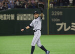 Seattle Mariners right fielder Ichiro Suzuki waves to spectators while leaving the field for defensive substitution in the eighth inning of Game 2 of the Major League baseball opening series against the Oakland Athletics at Tokyo Dome in Tokyo, Thursday, March 21, 2019. (AP Photo/Koji Sasahara)