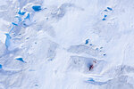 In this Aug. 16, 2019, photo, a helicopter carrying New York University air and ocean scientist David Holland and his team sits on the ice as they install a radar and GPS at the Helheim glacier, in Greenland. Scientists are hard at work there, trying to understand the alarmingly rapid melting of the ice. (AP Photo/Felipe Dana)