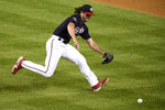 Washington Nationals relief pitcher Kyle Finnegan chases a ground ball by Miami Marlins' Jonathan Villar during the ninth inning of a baseball game, Friday, Aug. 21, 2020, in Washington. Villar was out at first in the play. The Marlins won 3-2. (AP Photo/Nick Wass)