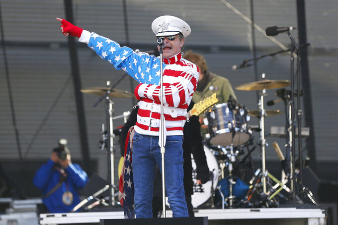 Cheap Trick performs outside Mercedes-Benz Superdome before the NFL football NFC championship game between the New Orleans Saints and the Los Angeles Rams Sunday, Jan. 20, 2019, in New Orleans. (AP Photo/Gerald Herbert)