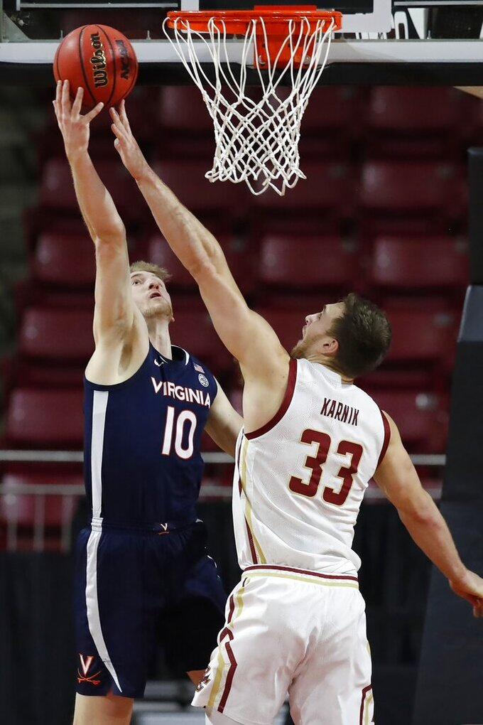 Virginia's Sam Hauser (10) shoots against Boston College's James Karnik (33) during the second half of an NCAA college basketball game, Saturday, Jan. 9, 2021, in Boston. (AP Photo/Michael Dwyer)