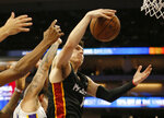 Miami Heat guard Tyler Herro, right grabs a rebound against Los Angeles Lakers guard Jeffrey Carroll during the first half of a NBA basketball summer league game in Sacramento, Calif., Monday, July 1, 2019. (AP Photo/Rich Pedroncelli)