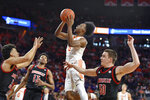 Clemson's John Newman lll (15) drives to the basket as Louisville's Jordan Nwora, left, David Johnson, center, and Ryan McMahon defend during the first half of an NCAA college basketball game Saturday, Feb. 15, 2020, in Clemson, S.C. Clemson won 77-62. (AP Photo/Richard Shiro)