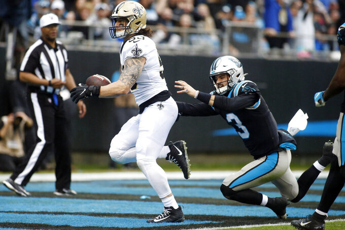 New Orleans Saints outside linebacker A.J. Klein (53) scores after an interception on Carolina Panthers quarterback Will Grier (3) during the first half of an NFL football game in Charlotte, N.C., Sunday, Dec. 29, 2019. (AP Photo/Brian Blanco)