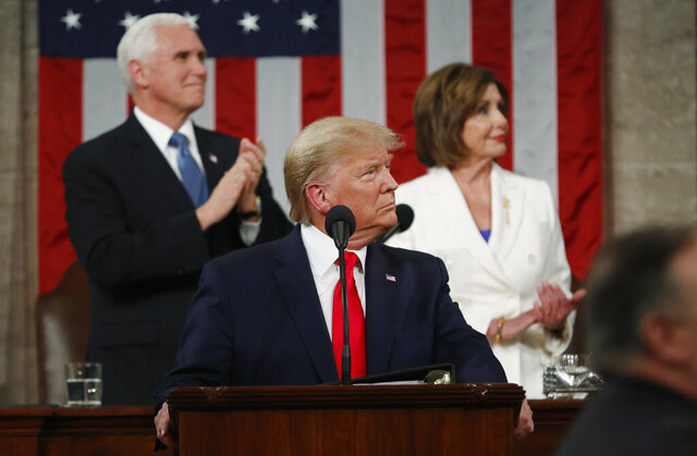 FILE - In this Feb. 4, 2020, file photo, President Donald Trump look to the first lady's box before delivering his State of the Union address to a joint session of Congress in the House Chamber on Capitol Hill in Washington,  as Vice President Mike Pence and Speaker Nancy Pelosi watch. Trump and Pelosi have not spoken in five months at a time when the nation is battling its worst health crisis in a century. (Leah Millis/Pool via AP)
