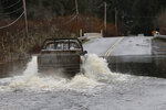 A truck drives through a flooded roadway, Tuesday, Jan. 7, 2020, near Littlerock, Wash. A storm that has brought record rainfall to the Northwest has prompted flood warnings, disrupted train traffic, closed roads and caused some power outages. (AP Photo/Ted S. Warren)
