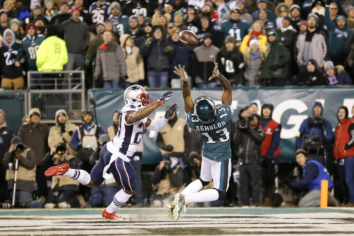 Philadelphia Eagles' Nelson Agholor (13) cannot catch a pass in the end zone against New England Patriots' J.C. Jackson (27) during the second half of an NFL football game, Sunday, Nov. 17, 2019, in Philadelphia. (AP Photo/Michael Perez)