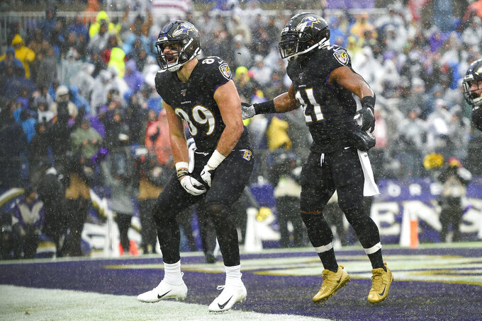 Baltimore Ravens tight end Mark Andrews (89) celebrates his touchdown against the San Francisco 49ers with teammate Mark Ingram (21) in the first half of an NFL football game, Sunday, Dec. 1, 2019, in Baltimore, Md. (AP Photo/Gail Burton)
