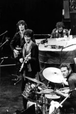 FILE - In this Nov. 27, 1976 file photo, The Band, Richard Manuel on piano, Levon Helm on drums, lead guitarist Robbie Robertson, center, and bass guitarist Rick Danko, take the stage for their final live performance before a crowd of 5,000 at Winterland Auditorium in San Francisco. Roberston, 76, said in a recent interview that he was in a melancholy mood when he wrote the song,