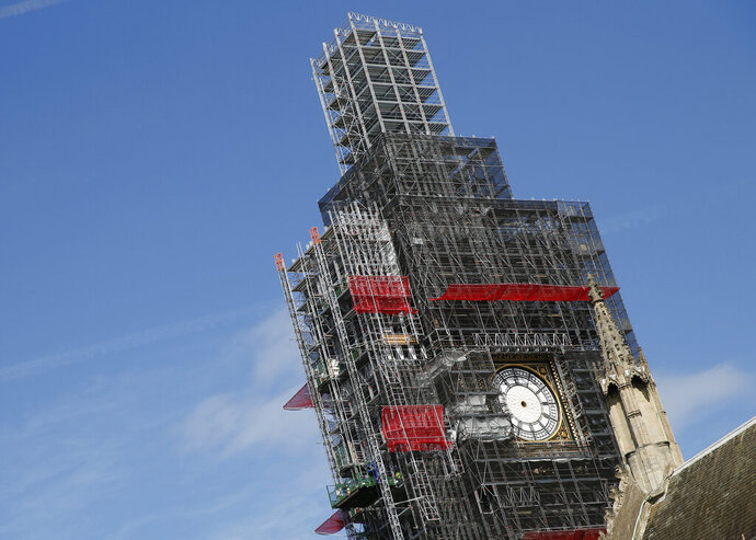 """FILE - In this Tuesday, April 17, 2018 file photo, scaffolding surrounds the Queen Elizabeth Tower, which holds the bell known as Big Ben, in London. The bell of Britain's Parliament has been largely silent since 2017 while its iconic clock tower undergoes four years of repairs. Brexit-backing lawmakers are campaigning for it to strike at the moment Britain leaves the European Union -- 11 p.m. (2300GMT) on Jan. 31. Parliamentary officials say it is not worth the cost, which could come to 500,000 pounds ($650,000). The House of Commons Commission said Tuesday, Jan. 14, 2020 that because the clock mechanism has been dismantled and the belfry is currently getting a new floor, arranging for the bell to ring """"could result in huge costs to the public purse."""" (AP Photo/Alastair Grant, file)"""