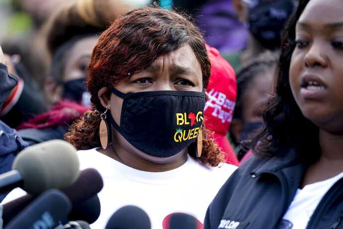 Tamika Palmer, the mother of Breonna Taylor, left, listens to a news conference, Friday, Sept. 25, 2020, in Louisville, Ky. Family attorney Ben Crump is calling for the Kentucky attorney general to release the transcripts from the grand jury that decided not to charge any of the officers involved in the Black woman's death. (AP Photo/Darron Cummings)