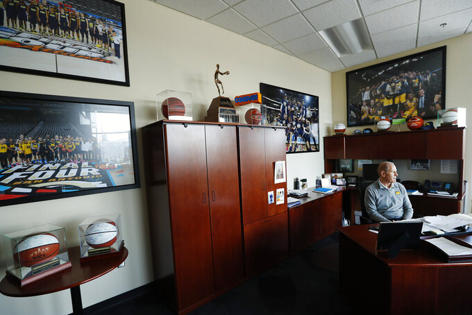 Michigan head basketball coach John Beilein sits in his office in Ann Arbor, Mich., Tuesday, Feb. 19, 2019. Beilein and Michigan State's Tom Izzo are friendly rivals, whose highly ranked NCAA college basketball teams will play for the first time this season on Sunday at Crisler Arena. As much as Beilein and Izzo genuinely like and respect each other, the highly competitive coaches want to win. (AP Photo/Paul Sancya)