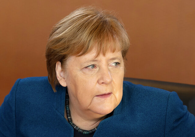 German Chancellor Angela Merkel arrives for the weekly cabinet meeting of the German government at the chancellery in Berlin, Germany, Wednesday, Feb. 5, 2020. (AP Photo/Jens Meyer)