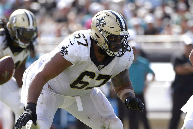 FILE - In this Oct. 13, 2019, file photo, New Orleans Saints' Larry Warford (67) blocks against the Jacksonville Jaguars during the second half of an NFL football game in Jacksonville, Fla. The Saints have cut three-time Pro Bowl right guard Warford, whose three-year run as a starter was cast into doubt by the club's selection of interior lineman Cesar Ruiz in the first round of the recent NFL draft. Warford's termination was announced by general manager Mickey Loomis on Friday, May 8, 2020. (AP Photo/Phelan M. Ebenhack, File)