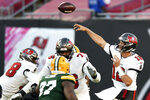 Tampa Bay Buccaneers quarterback Tom Brady (12) throws a pass against the Green Bay Packers during the second half of an NFL football game Sunday, Oct. 18, 2020, in Tampa, Fla. (AP Photo/Jason Behnken)