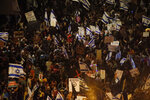 Thousands protest against Israel's Prime Minister Benjamin Netanyahu in front of his official residence in Jerusalem, Saturday, Aug. 8, 2020.  (AP Photo/Ariel Schalit)
