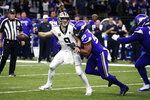 File-This Jan. 5, 2020, file photo shows New Orleans Saints quarterback Drew Brees (9) fumbling as he is hit by Minnesota Vikings defensive end Danielle Hunter (99) in the second half of an NFL wild-card playoff football game in New Orleans. Hunter's absence last season to a neck injury contributed to Minnesota's demise on defense, and the Vikings could use the No. 14 pick in the draft for another boost.  (AP Photo/Butch Dill, File)