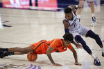 Pacific guard Daniss Jenkins, left, and Gonzaga guard Joel Ayayi go after the ball during the second half of an NCAA college basketball game in Spokane, Wash., Saturday, Jan. 23, 2021. (AP Photo/Young Kwak)