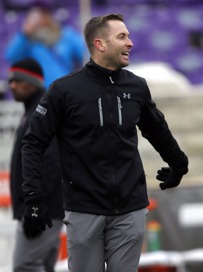 Texas Tech head coach Kliff Kingsbury watches warm ups before an NCAA college football game against Kansas State in Manhattan, Kan., Saturday, Nov. 17, 2018. (AP Photo/Orlin Wagner)