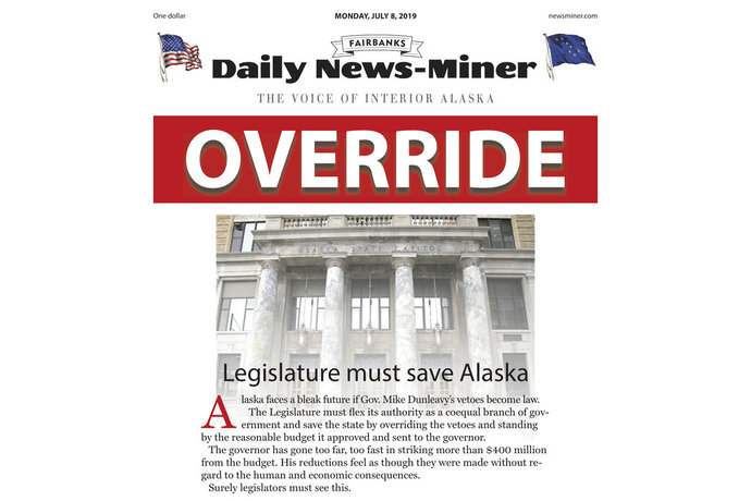 This image shows a part of the PDF graphic of the front page of the Fairbanks Daily News-Miner for the Monday, July 8, 2019, edition. The nearly 2-inch (5-centimeter) headline, outlined in red, in Monday's edition of the newspaper contained a single word: OVERRIDE. It appeared over a full-page editorial calling for state lawmakers to