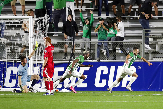 Marshall's Jamil Roberts (11) celebrates his game-winning goal in overtime of the NCAA College Cup championship soccer match against Indiana in Cary, N.C., Monday, May 17, 2021. Marshall won 1-0 in overtime. (AP Photo/Karl B DeBlaker)
