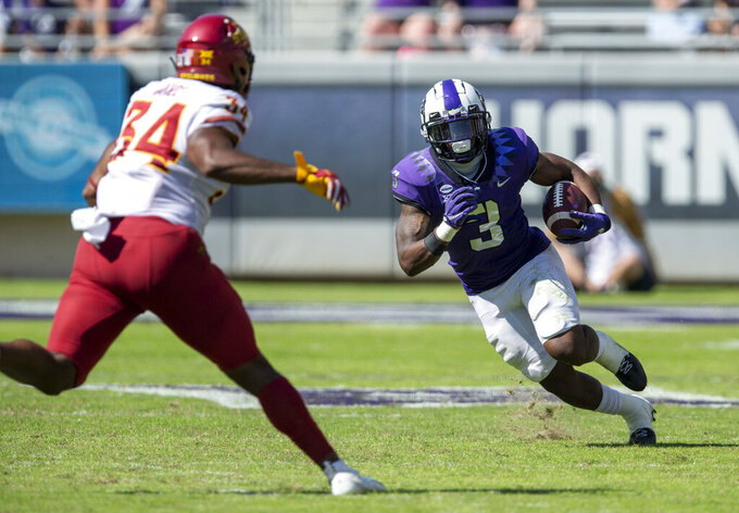 TCU running back Emari Demercado (3) looks for room against Iowa State linebacker O'Rien Vance (34) during an NCAA college football game on Saturday, Sept. 26, 2020 in Fort Worth, Texas. Iowa won 37-34. (AP Photo/Brandon Wade)