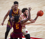 Nebraska guard Kobe Webster (10) collides with Minnesota's Marcus Carr (5) and is called for an offensive foul, as Minnesota's Eric Curry (24) watches during the first half of an NCAA college basketball game Saturday, Feb. 27, 2021, in Lincoln, Neb. (Francis Gardler/Lincoln Journal Star via AP)