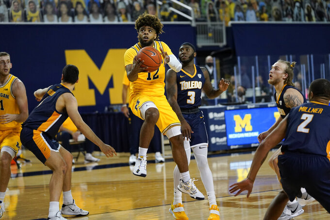 Michigan guard Mike Smith (12) drives against Toledo in the second half of an NCAA college basketball game in Ann Arbor, Mich., Wednesday, Dec. 9, 2020. (AP Photo/Paul Sancya)