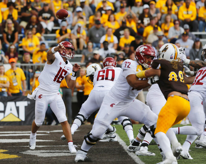 Washington State quarterback Gardner Minshew II delivers a pass against Wyoming during an NCAA college football game Saturday, Sept. 1, 2018, in Laramie, Wyo. Washington State defeated Wyoming 41-19. (Alan Rogers/The Casper Star-Tribune via AP)