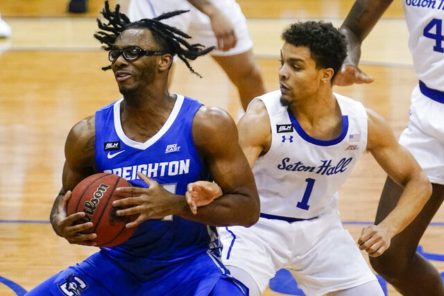 Creighton's Denzel Mahoney, left, spins away from Seton Hall's Bryce Aiken during the first half of an NCAA college basketball game Wednesday, Jan. 27, 2021, in Newark, N.J. (AP Photo/Frank Franklin II)