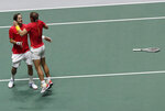 Spain's Rafael Nadal, right, and Feliciano Lopez celebrate after winning their Davis Cup semifinal doubles match against Great Britain's Jamie Murray and his partner Neal Skupski in Madrid, Spain, early Sunday, Nov. 24, 2019. (AP Photo/Bernat Armangue)