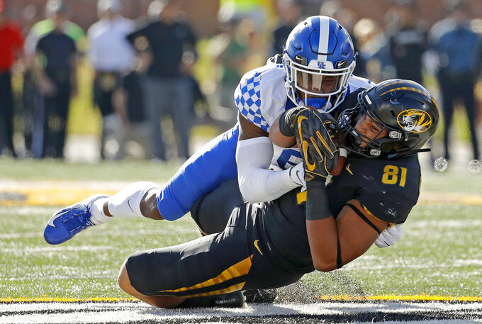 Missouri tight end Albert Okwuegbunam (81) is tackled by Kentucky cornerback Lonnie Johnson Jr. (6) during the first half of an NCAA college football game Saturday, Oct. 27, 2018, in Columbia, Mo. (AP Photo/Charlie Riedel)