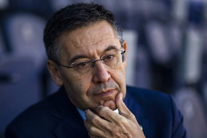 In this Friday, Nov. 8, 2019, photo, President of FC Barcelona Josep Bartomeu pauses during and interview with the Associated Press at the Camp Nou stadium in Barcelona, Spain. Bartomeu told The Associated Press on Friday that