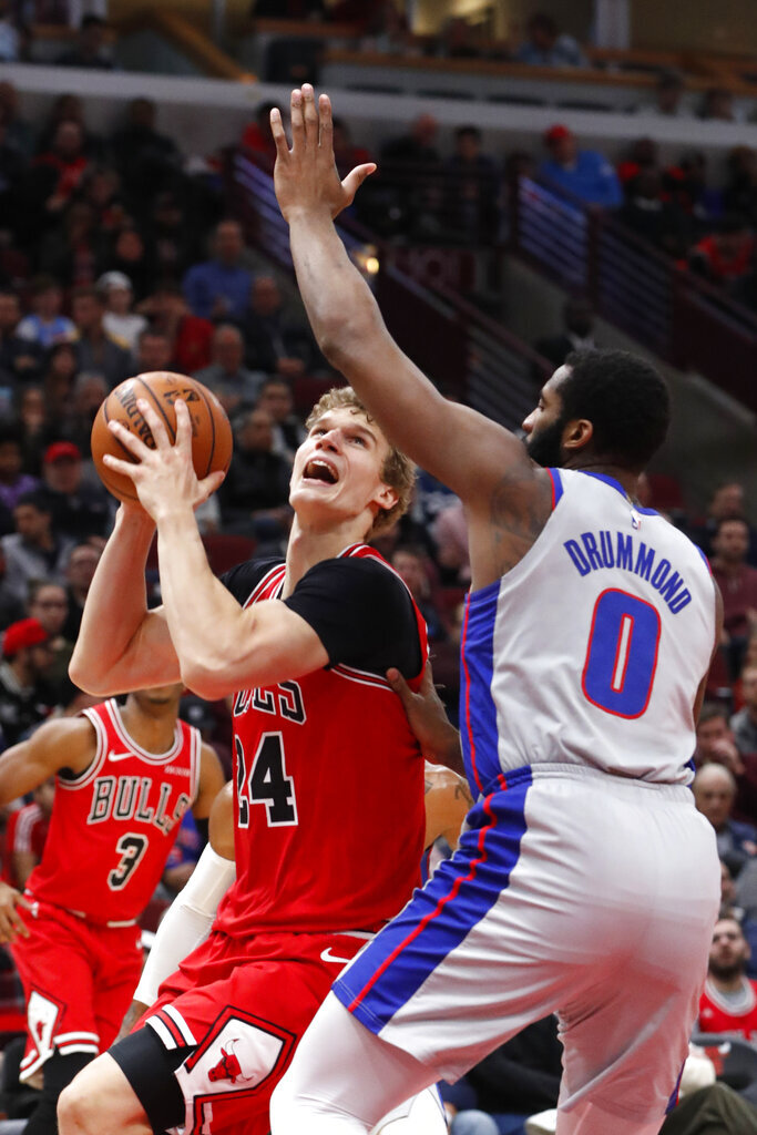 Chicago Bulls' Lauri Markkanen (24) looks to shoot over Detroit Pistons' Andre Drummond during the second half of an NBA basketball game Wednesday, Nov. 20, 2019, in Chicago. The Bulls won 109-89. (AP Photo/Charles Rex Arbogast)