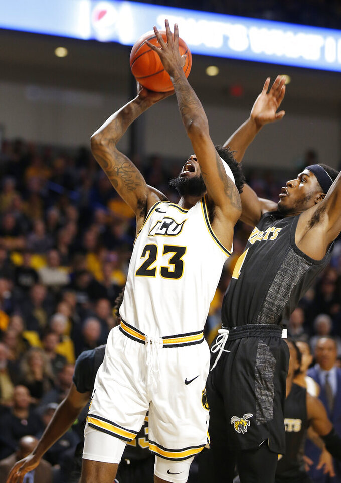 Virginia Commonwealth's Issac Vann (23) shoots over Alabama State's Leon Daniels (1) during an NCAA college basketball game in Richmond, Va., Monday, Nov. 25, 2019. (James H. Wallace/Richmond Times-Dispatch via AP)