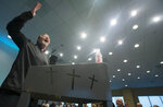 Pastor Bradley Hill addresses his congregation at the Grace Downtown church in Winchester, Va., Sunday, Oct. 14, 2018. About four years ago, he came to Winchester and started Sunday services in the backroom of a downtown bar called Brewbaker's for a handful of people struggling with addiction. (AP Photo/Steve Helber)